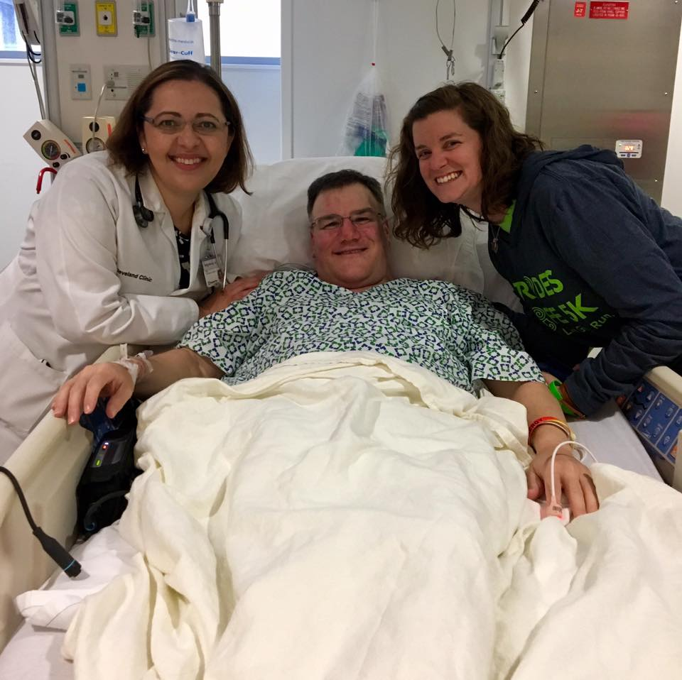 Pat waiting to receive his heart transplant with his Cardiologist, Dr. Maria Mountis and his wife, Amy.