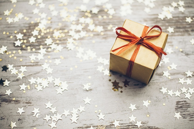 Christmas present, glitter stars and bokeh